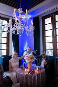 Bride and Groom at Sweetheart Table at Chez Vincent in Winter Park - Bohemian Gatsby Inspired Wedding - Photo by Jamie Reinhart Photography - Kraft Azaela Gardens Wedding in Winter Park, FL - click pin for more - www.orangeblossombride.com