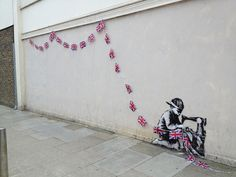 New Banksy spotted in Turnpike Lane London. Child labour getting set for the Queens Jubilee. May 14, 2012