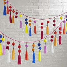Shop Rainbow Tassel Garland. This colorful hanging garland is like a party for your décor. It's adorned with playful tassels, pom poms and wooden beads for a truly festive look. Find to help you decorate your nursery or kids' room with family photos, personalized decor and more.