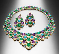 BULGARI ~ The Bib necklace and a pair of matching earrings dates from 1965. Set…