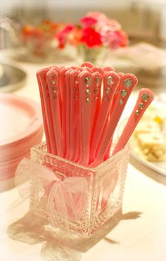 This is a GREAT idea!!!  Rhinestones glued on plastic pink forks -- so cute for a girl's party.  Any color, really, but pink would be perfect for our Eloise party! :)