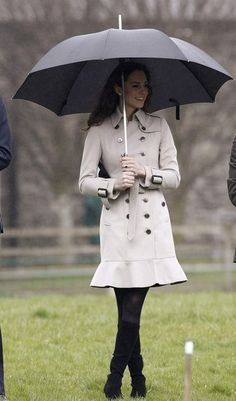 Kate Middleton in a gorgeous trench while visiting Northern Ireland in March, 2011.
