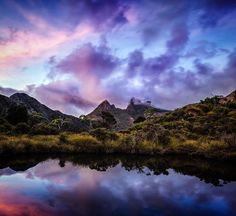 P A P I L I O Cradle Mountain Tasmania Its hard to imagine with so many amazing images coming from Tasmanias famous landmark that the top of this jagged mountain is only visible about 30 days of the year the rest of the time it's peak sits in a cloudy sky. On my recent tour we were lucky enough to capture Cradle Mountain in glorious sunset and sunrise colours. This place reminds me of the transformation from caterpillar to butterfly and is one of the most exquisite visions in the natural…