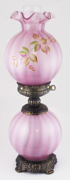 *FENTON ART GLASS ~ Gone With The Wind style Lamp in Madrasa Pink w/the refreshing meadow Berry. Ronbins Spindlers intricate handpainted design uses layers of sheer color a special sponge treatment to create just the right burnished effect. Antique Oil Lamps, Old Lamps, Antique Lighting, Vintage Lamps, Fenton Lamps, Fenton Glassware, Antique Glassware, Hurricane Oil Lamps, Victorian Lamps