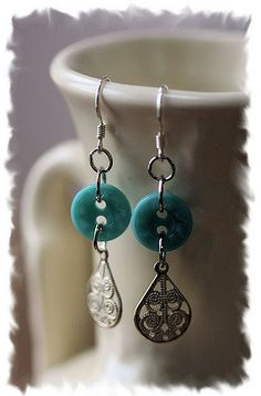Earrings, buttons and a recycled filigree piece made into a new earring set.  Sent to Melissa