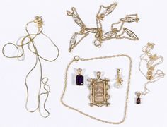 Lot 308: 14k Gold Jewelry Assortment; Including three necklaces, four gemstone pendants and a bracelet