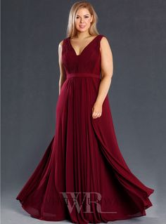 Eluna Gown. A gorgeous full length dress by Jadore. A flattering v-neck style featuring gathers on the bodice and a flowy skirt.
