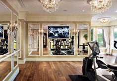 Traditional Home Gym with Hardwood floors, Chandelier, Crown molding, tv wall mount, interior wallpaper, Wall sconce