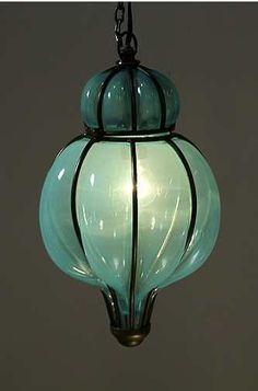 beautiful blown glass lantern. Love the color, like sea glass.