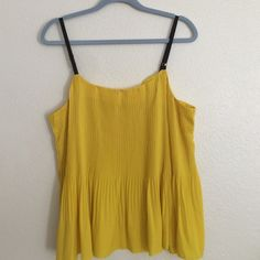 Yellow tank Adorable Yellow accordion like top. Perfect for a night on the town and flowy so you can breathe! Runs big. Worn once. RACHEL Rachel Roy Tops Tank Tops