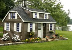 The illusion of a big house...... By entering from the long side and adding the shed dormer to that same side, the front of the house becomes more imposing. This house could conceivably be about 12-14 ft by 20-24 ft.