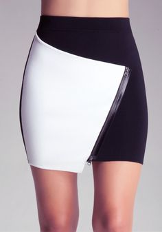 Knockout. Our colorblock meets asymmetric design is absolutely stunning as a mini skirt. Real zipper and crossover detail with no closures.