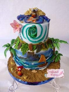Moana Cake. This cake is So elaborate! Look at all the details. Tamatoa (Shiny Crab), Hei Hei the Chicken, Moana's Canoe and flower, Maui's leaf skirt and Tatoo's, The heart of Tafiti, Sand and Waves! So cool!!!
