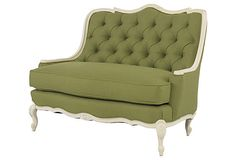 Love the scalloped frame of this green and white settee!