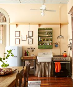 Love everything about this apartment in New Orleans. Eclectic Kitchen by Logan Killen Interiors