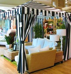 My backyard entertaining and dinner partying is taken to another level under my beautiful black and white Portofino Pavilion stripedcabana with elegant seating and gorgeous accessories!!