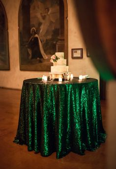 Add a sequined table cloth in your wedding color for an exciting pop of color!