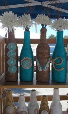 Reciclado botellas de vino envuelto en el diseño de amor de