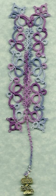 Flowering Quatrain Bookmark designed by Frivole. Thead: HH Grape Splash 165 size 20. http://leblogdefrivole.blogspot.com/2012/06/flowering-quatrain-bookmark-pattern.html