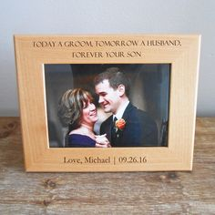 This personalized mother of the groom picture frame makes a great, custom keepsake for mom who will always remember this special day. The special note, your name, and wedding date (as shown in photo, or provide your own) are laser engraved onto the wood frame.