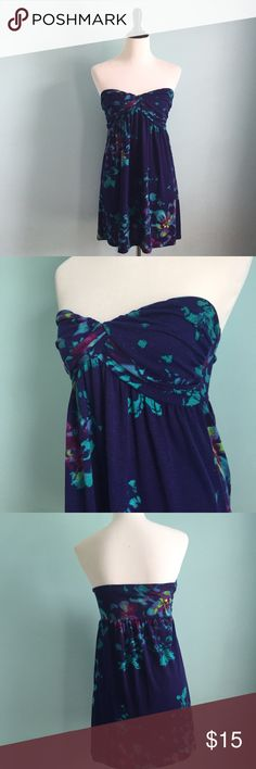 Delia's Strapless Dress Indigo strapless delia's dress with lighter blue and pink floral designs. Great as a bathing suit cover up or just a comfortable dress. Stretchy size small. Blush Dresses Strapless