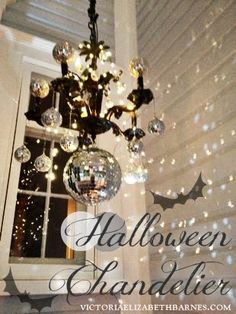 Decorating our old-house's front porch for Halloween… I lined the walkway with mason jars and tea lights, and made a DIY Halloween chandelier