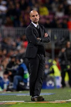 Manchester City's Spanish coach Pep Guardiola looks on during the UEFA Champions League football match FC Barcelona vs Manchester City at the Camp Nou stadium in Barcelona on October 19, 2016. / AFP / JOSEP LAGO
