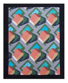 """Erick Wolfmeyer. His work rests solidly in the camp of """"classical"""" piecing; the kind seen in quilting for the last several centuries. His approach is subtle, using a visual language that references both modern art and the use of quilts as wall art, yet he consciously makes his works with utility in mind. His colors are used to make 3-D shapes and give depth to the picture plane."""