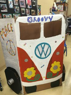 60's VW van made from cardboard box, glossy acrylic paint, recycled cardboard wheels. Book fair photo prop.