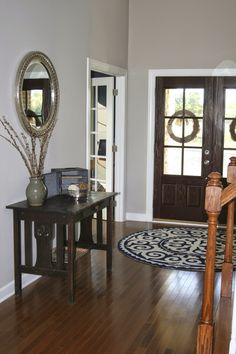 Entryway Paint: Revere Pewter (Benjamin Moore). I like the dark wood floor color too. #reverepewter
