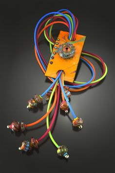 Bola - My take on a western bola! Handmade glass, Enameled Copper and Rubber - Kathryn Guler