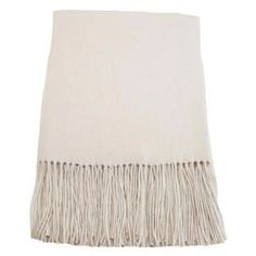 "Fringed merino wool throw.    Product: Throw    Construction Material: 100% Merino wool   Color: Cream    Features: Six inch fringeOffers luxurious comfort  Dimensions: 65"" x 50""          Cleaning and Care: Dry clean only"