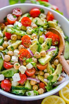 Chickpea Salad Recipe NatashasKitchen com is part of Chickpea salad recipes - Chickpea Salad loaded with crisp cucumbers, juicy tomatoes, creamy avocado, feta cheese and chickpeas or garbanzo beans Fresh, healthy and protein packed! Chickpea Salad Recipes, Best Salad Recipes, Vegetarian Recipes, Cooking Recipes, Healthy Recipes, Recipes With Garbanzo Beans, Chickpea Feta Salad, Salad Recipe With Chickpeas, Cooking Games