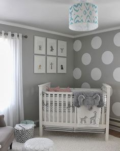 Gender neutral nursery decor ideas we love: Neutral palettes with stuffed animals and fluffy carpets.