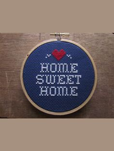 Not too early to get a little handmade gift action on Home Sweet Home Do-It-Yourself Cross-Stitch Kit $12