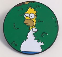 """Brand new! Homer Simpson shrinking into a bush enamel pins (we've all been there.) A great item for any Simpsons fan. Item is 1.5"""" x1.5"""" and has two metal pin backs. These items are limited to 100. On"""