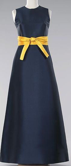Madam Gres 1968 this is simple and cute. I would make the dress shorter and add sleeves or a jacket.
