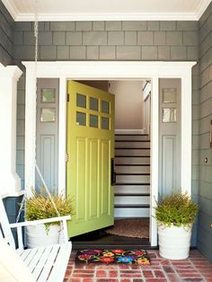 Love the color of the door with the grey exterior