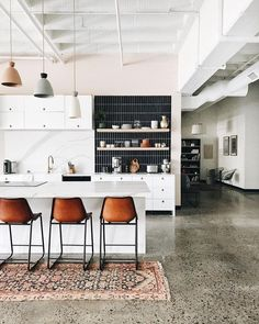 14 Reasons to Consider Dreamy Concrete Kitchen Floors - polished concrete kitchen floors in modern kitchen with area rug - Boho Kitchen, Kitchen Rug, Apartment Kitchen, Kitchen Flooring, New Kitchen, Clean Apartment, Kitchen Ideas, Kitchen Modern, Kitchen Layout