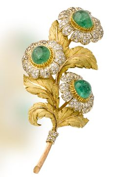 An eighteen karat gold, emerald and diamond flower brooch, Buccellati  designed as a spray of three flowers, each centering a circular cabochon emerald within petals of pavé-set single-cut diamonds, with textured gold leaves; signed M. Buccellati, with signed box; length: 3in. (two emeralds with large surface reaching inclusions)