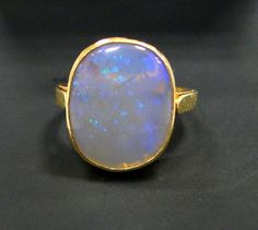 18 K solid gold natural Opal ring