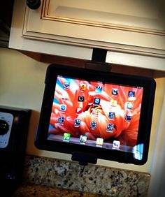 iPad holder for the kitchen cabinets. geat gadget for those cookbooks i have on the kindle app