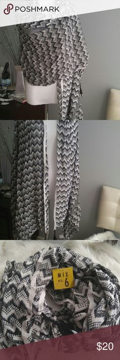 Black & white long scarf. Black and white scarf with tassels on the corners. Pretty scarf can wear different ways, you choose. Accessories Scarves & Wraps