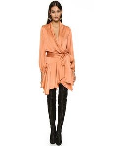 Opt for a sophisticated take on evening wear dressing courtesy of Zimmermann's brushed silk Empire robe dress. Detailed with a wrap front and long-sleeves, this plunging style is finished with a self-tie waist to cinch the silhouette. Complement the orange hue by wearing yours with bare legs, stiletto-heeled sandals and minimal jewels.
