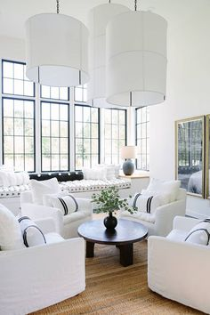 This modern family home in Nashville is drenched in sunlight and makes a strong case for all-white décor. Take a tour. Living Room Interior, Home Interior Design, Living Room Furniture, Living Room Decor, Interior Ideas, Modern Interior, Wooden Furniture, Living Room White Walls, White Living Room Chairs