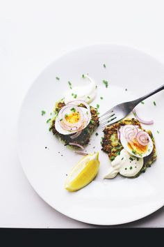 Zucchini fritters with soft boiled eggs, red onions & creme fraiche   At the breakfast table