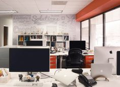 One of the company's floor-to-ceiling branding walls. Work Stations, Cool Office, Corner Desk, Walls, Branding, Ceiling, Flooring, Furniture, Home Decor