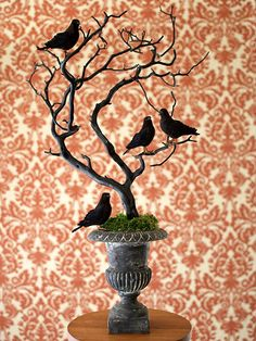 Spooky Still Life. Make ordinary objects a little creepier with a coat of black paint. Just a few simple steps and this discarded tree branch becomes a scary perch for menacing ravens. Find a tree branch (the more twisted and gnarled, the better) and spray-paint it black. Once dry, insert the branch in an urn or pot. Finish by placing a few black ravens on the branch.