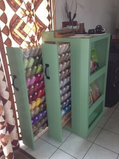 Long Arm thread storage custom made by the quilters hubby.