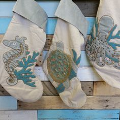 Stunning velvet applique sea creatures detailed with beading in gold and aqua for our Christmas Stockings!  Braided trim finishes off the high style nature of the Saltwater Serenity Christmas collection!  Choose Octopus, Seahorse and Turtle.